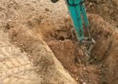 挖掘机驾驶拖拉机在建筑地盘工作 — 图库照片