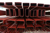 Pile of steel beam in building construction site — Stock Photo