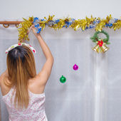 Woman decorate christmas in home — Stock Photo