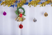 Christmas background, bell and ball decorate on white curtain — Stock Photo