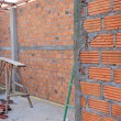 Brick wall in residential building construction site — Stock Photo #54344785
