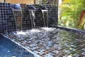 Flowing water decorated in swimming pool — Stockfoto