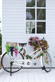 White bike standing decorated in white home — Stock Photo