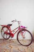 Classic old bicycle decorated with pink flower — Photo
