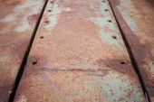 Rusty metal plate corroded aged texture background — Stockfoto