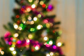 Christmas light on tree, abstract defocused background — Foto de Stock