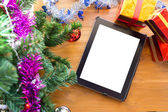 Black tablet on table wood with christmas decoration — Fotografia Stock