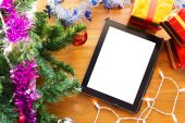 Black tablet on table wood with christmas decoration — Stock Photo