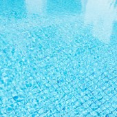 Ripple water in blue swimming pool — Stock fotografie