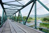 Iron bridge at pai river in thailand — Stock Photo