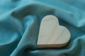Heart  wooden box on cloth fabric background — Stock Photo