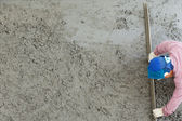 Plasterer concrete cement worker plastering flooring of house co — Stock Photo
