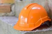 Orange safety helmet, safety equipment of construction worker — Stock Photo