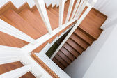 Wooden staircase made from laminate wood in white modern house — Stockfoto