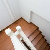 Wooden staircase made from laminate wood in white modern house — 图库照片