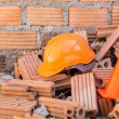 Hard hat safety helmet and cone in construction site — Stock Photo #61524761