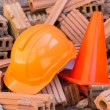 Hard hat safety helmet and cone in construction site — Stock Photo #61524769