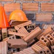 Hard hat safety helmet and cone in construction site — Stock Photo #61524777