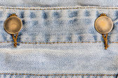 Jeans denim clothing with metal button on clothing textile indus — Stock Photo