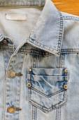 Jean shirt with pocket and metal button on clothing textile indu — Stock Photo