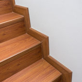 Wooden staircase made from laminate wood in white modern house — Stock Photo