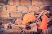 Construction helmet safety and cone in construction site — Stok fotoğraf