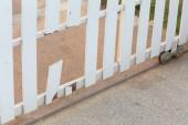 White wood fence of broken damaged — Stock Photo