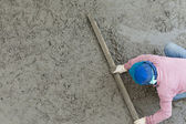 Plasterer concrete cement worker plastering flooring — Stock Photo