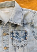 Jean shirt with pocket and metal button on clothing textile — Stock Photo