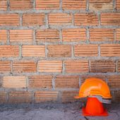 Construction helmet safety and cone in construction site — Stock Photo