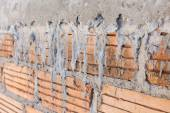Close up brick wall background in construction site — Zdjęcie stockowe