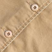 Brown shirt background with stitch seam textile and botton — Stok fotoğraf