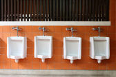 Decor interior of white urinals in men bathroom toilet — Stock Photo