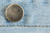 Old metal button of jeans fashion — Stock Photo