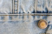 Jeans denim clothing with metal button on clothing textile — Stock Photo