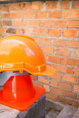 Construction helmet safety and cone in construction site — ストック写真