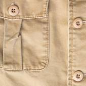 Front pocket on brown shirt textile texture background — Stock Photo