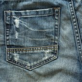 Back pocket of fashion blue jeans — Stock Photo