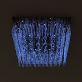 Chandelier crystal blue light on black wall background — Stockfoto