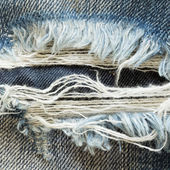 Denim jeans with old torn of fashion jeans design — Stock Photo