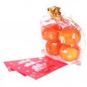 Red envelope and orange fruit of chinese new year decoration — Stock Photo