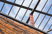 Steel beams roof truss residential building construction — Stock Photo
