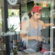 Handsome man barista working make a coffee drink at cafe — Foto de Stock   #82295876