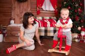Mother playing with her child in christmas decoration — Foto de Stock