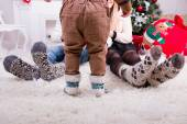 Feeds of man woman and they child near christmas tree — Stock Photo
