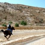 Bedouin horse riding in the desert near Petra Jordan — Stock Photo #78134970