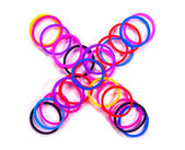 Colorful rubber band multiply symbol. — Stock Photo