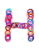 "Colorful rubber band character ""H"". — Stock Photo"
