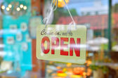 Open sign broad through the glass of window — Stock Photo