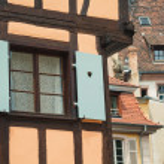 Old half timber (fachwerk) windows on house in Colmar, France. — Stock Photo #57576865